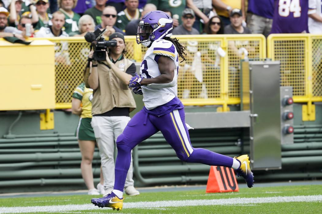 Minnesota Vikings' Dalvin Cook runs for a touchdown during the first half of an NFL football ga ...