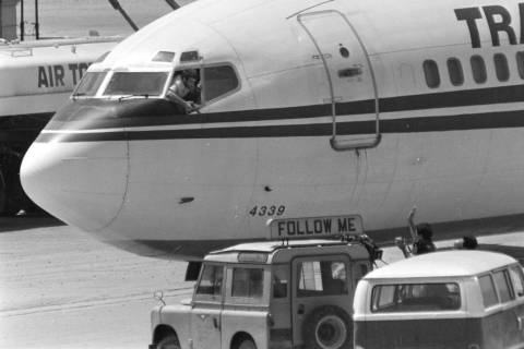 FILE - In this Wednesday, June 19, 1985 file photo, a hijacker points a weapon toward an ABC ne ...