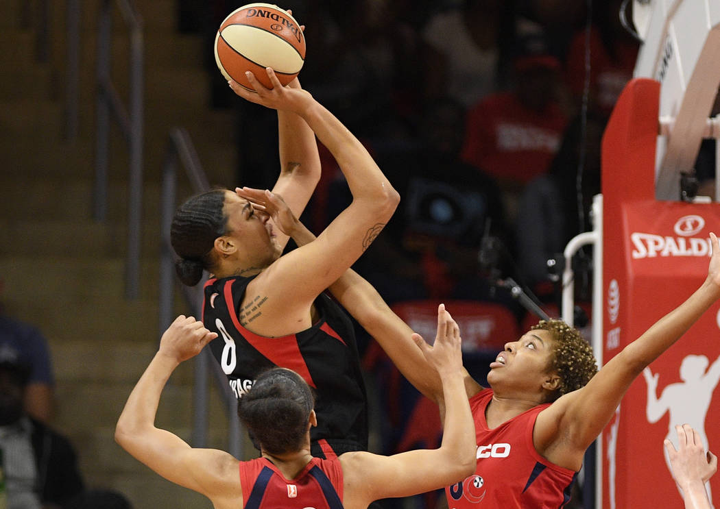 Las Vegas Aces center Liz Cambage (8) shoots above Washington Mystics forward Aerial Powers (23 ...