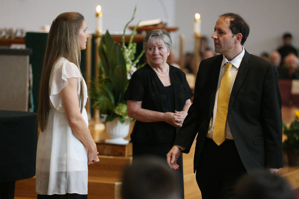 Kara Davis, left, and her husband Sean, are seen during the funeral mass for their daughter Pau ...
