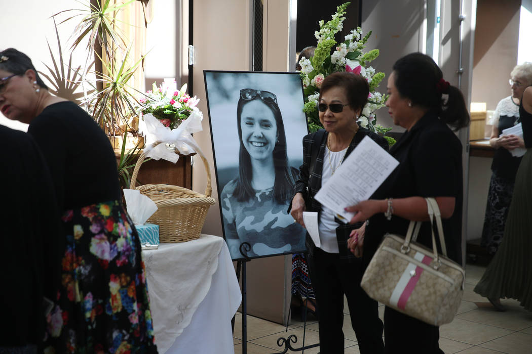 People attend the funeral mass for Paula Davis, a former UNLV economics student, at St. John Ne ...