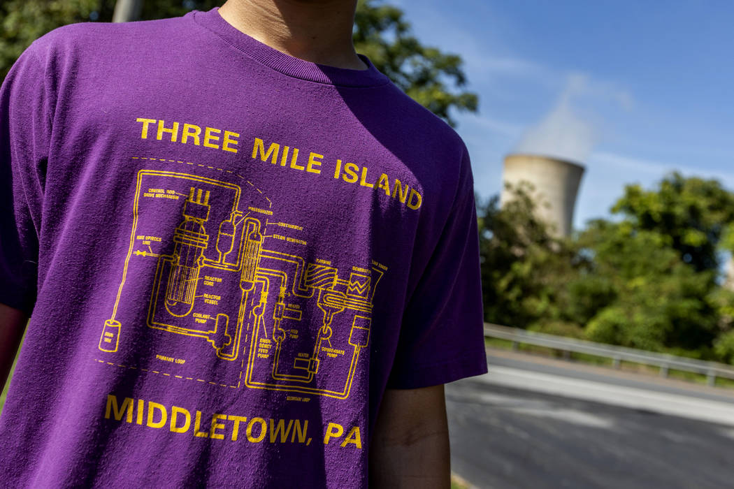 Levi Hess, of Hershey, wears a Three Mile Island shirt from the 1980's, before a press conferen ...