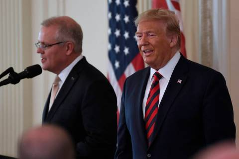 President Donald Trump and Australian Prime Minister Scott Morrison arrive for a news conferenc ...