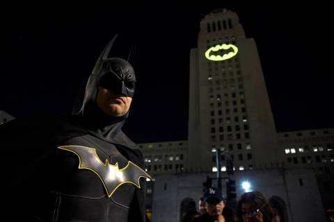 FILE - In this June 15, 2017 file photo, Tony Bradshaw, of Los Angeles, dressed as Batman, pose ...