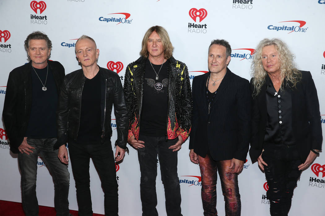 Def Leppard poses on the iHeartRadio red carpet at T-Mobile Arena in Las Vegas, Saturday, Sept. ...