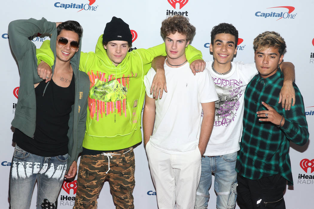 In Real Life poses on the iHeartRadio red carpet at T-Mobile Arena in Las Vegas, Saturday, Sept ...