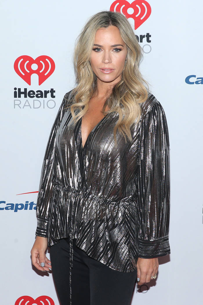 Teddi Mellencamp poses on the iHeartRadio red carpet at T-Mobile Arena in Las Vegas, Saturday, ...