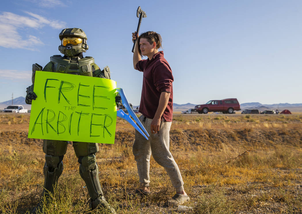 Spencer Smith of Louisiana, right, moves in close to a character from Halo during the Alienstoc ...