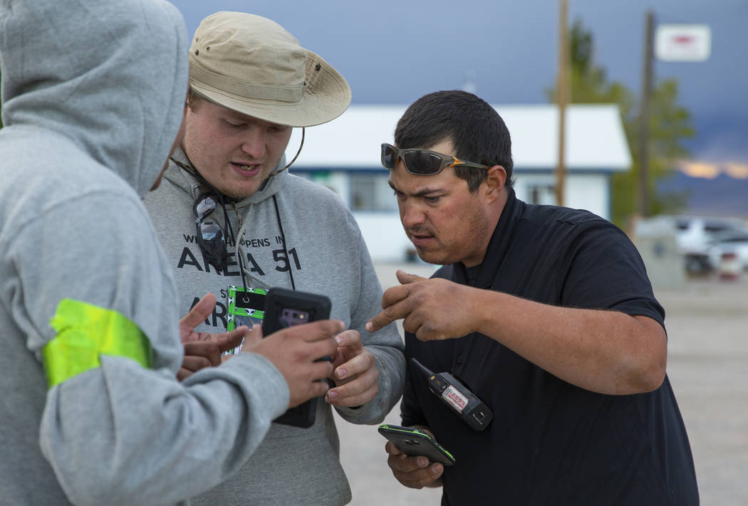 Volunteers Javy Morales, from left, and Brandon Misciagna work on parking details with Cody The ...