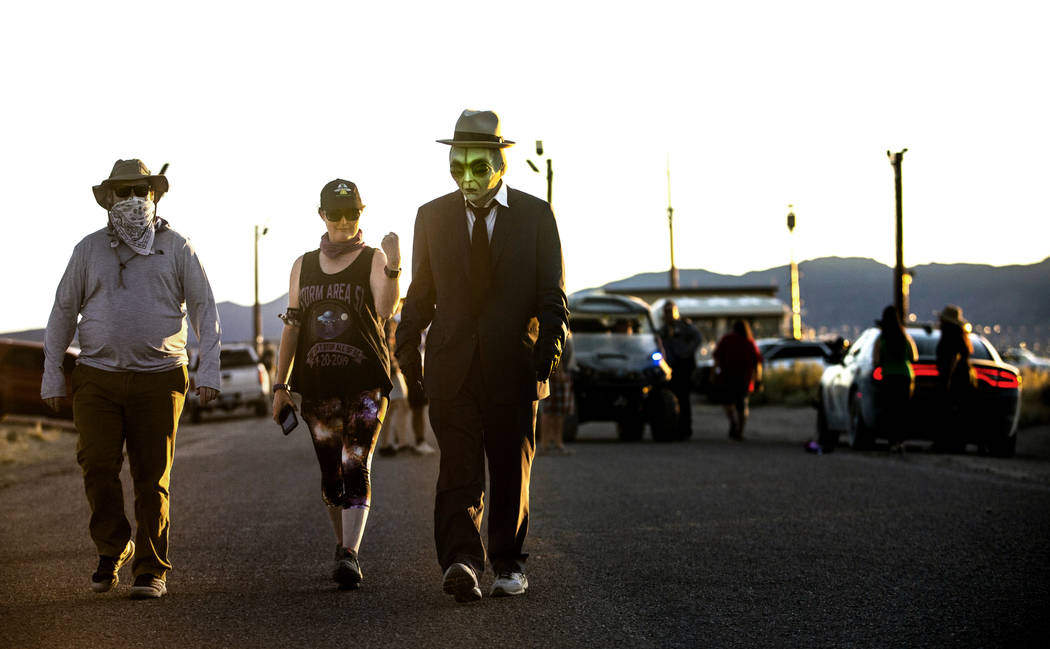 Visitors walk away from the back gate of Area 51 during the Alienstock festival on Saturday, Se ...