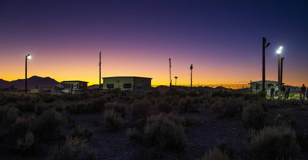 Sunset falls on the back gate of Area 51 during the Alienstock festival on Saturday, Sept. 21, ...