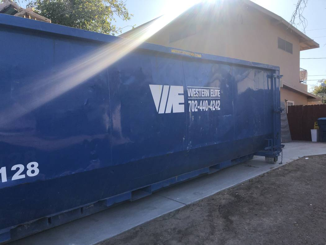A blue dumpster sits in the driveway of 3105 Parkdale Avenue on Saturday, September 21, 2019. T ...