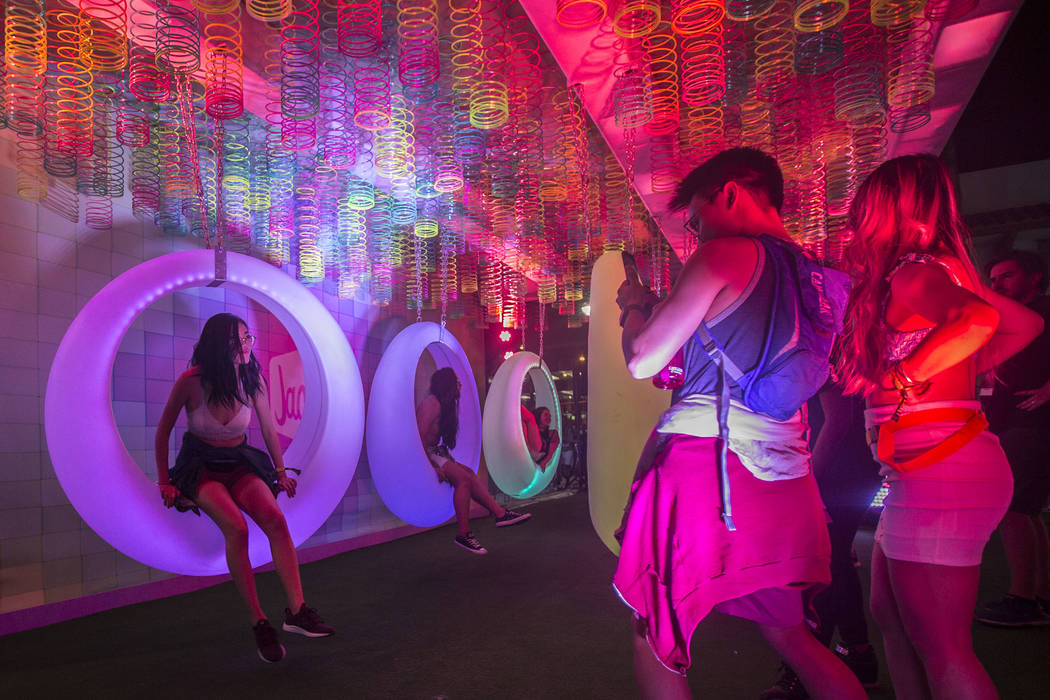 Festival goers pose for photos at Jack's Playground during the first day of Life is Beautiful o ...