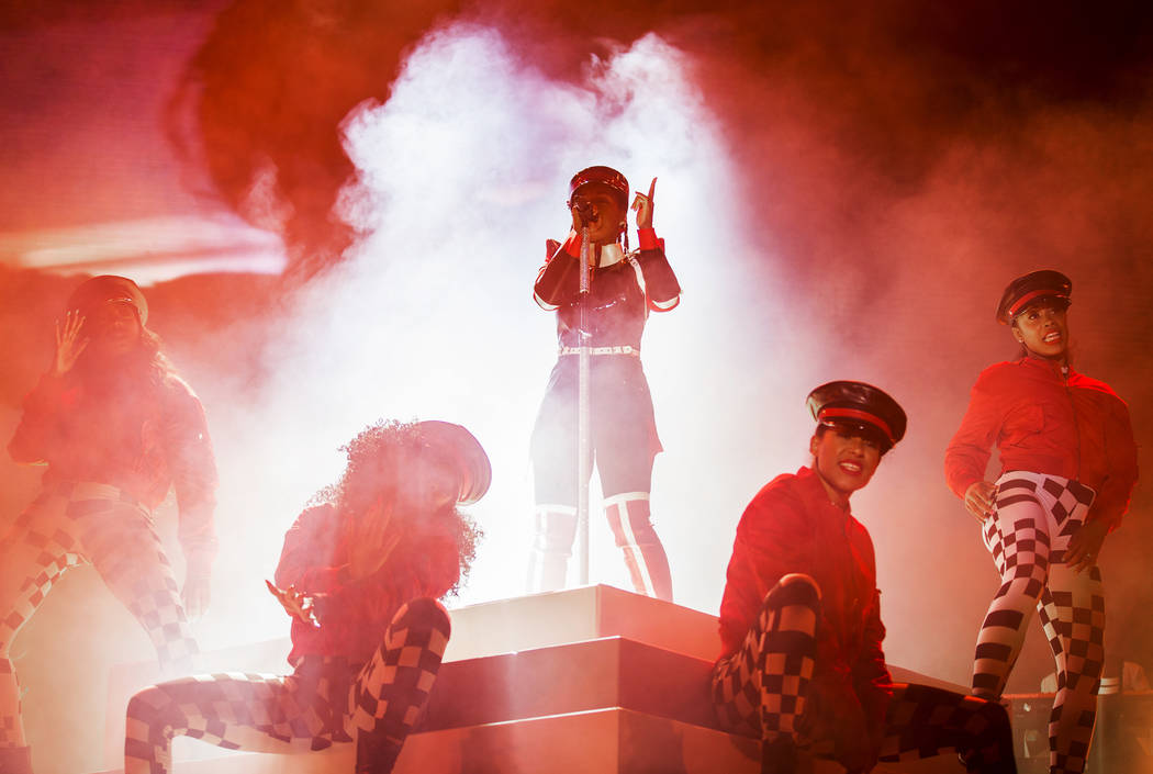 Janelle Monáe, top/middle, performs on the Bacardi Stage during the second day of Life is ...