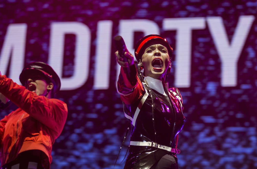Janelle Monáe, right, performs on the Bacardi Stage during the second day of Life is Beaut ...