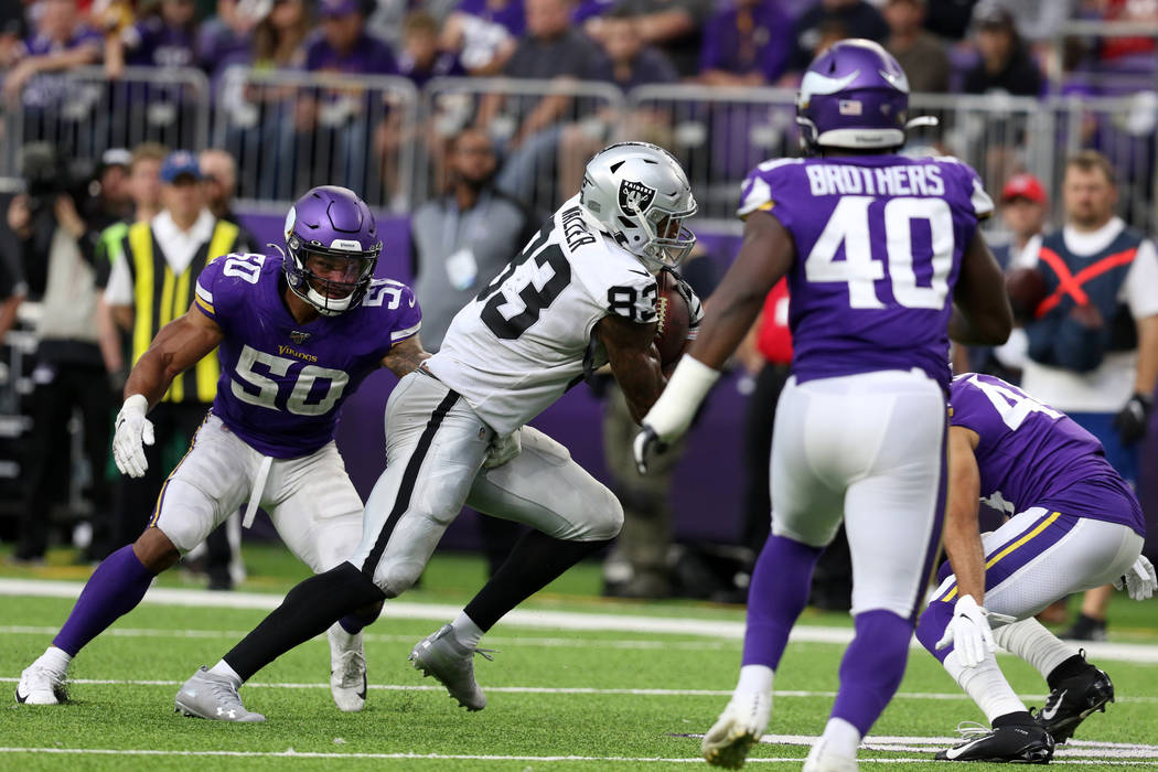 Oakland Raiders tight end Darren Waller (83) sheds a tackle from Minnesota Vikings linebacker E ...