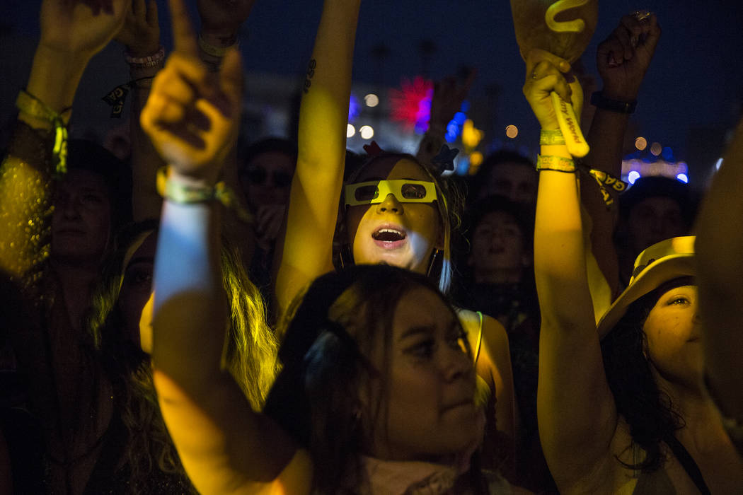 Fans cheer for Taylor Bennett, brother of Chance the Rapper, at the Huntridge Stage during the ...