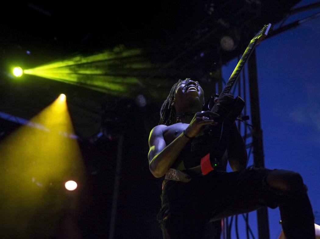 Taylor Bennett's guitarist performs on the Huntridge Stage during the second day of Life is Bea ...