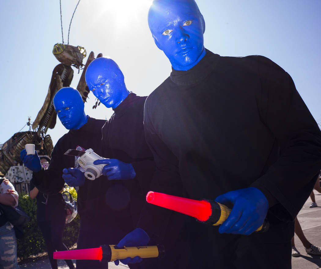 Members of the Blue Man Group roam the crowd during day 2 of the Life is Beautiful festival in ...