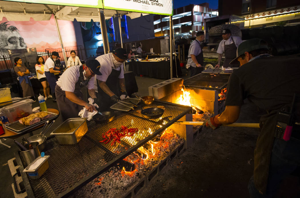 Food is prepared at The Cookout, a live fire cooking experience curated by Chef Justin Kingsley ...