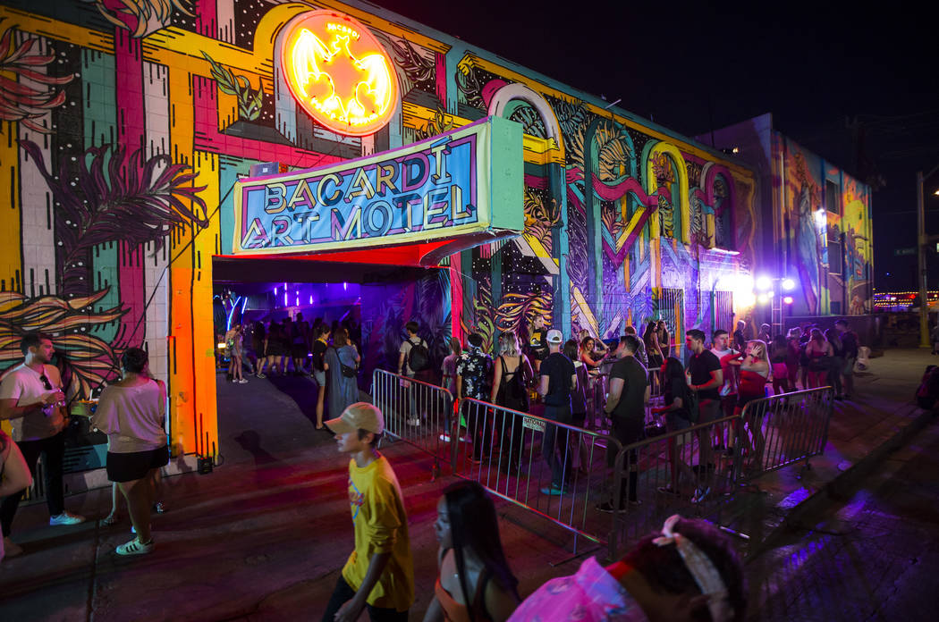 Attendees line up to get into the Bacardi Art Motel during day 2 of the Life is Beautiful festi ...