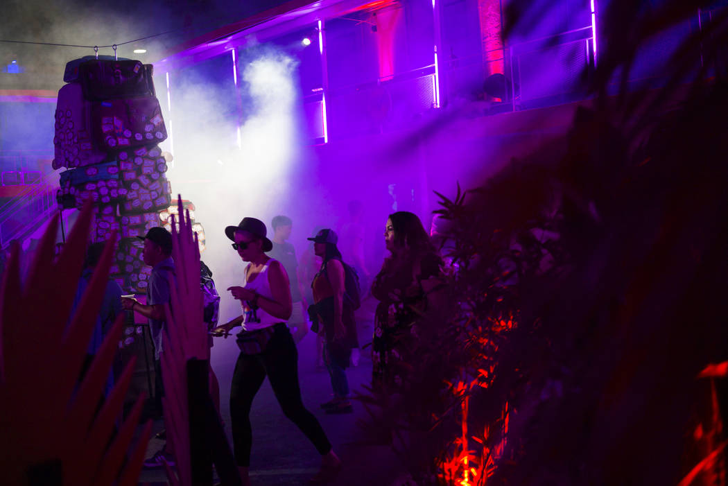 Attendees explore the Bacardi Art Motel during day 2 of the Life is Beautiful festival in downt ...