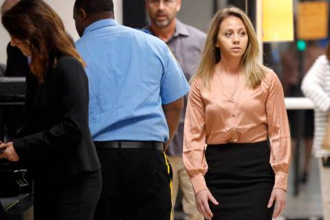 FILE - In this Sept. 13, 2019 file photo, fired Dallas police Officer Amber Guyger, right, arri ...