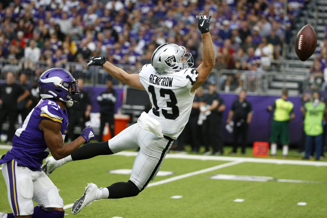 Minnesota Vikings cornerback Mike Hughes, left, breaks up a pass intended for Oakland Raiders w ...