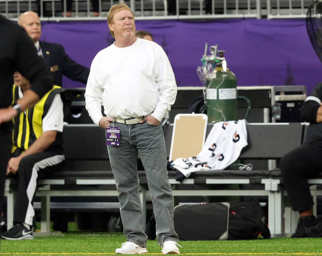 Oakland Raiders owner Mark Davis watches the team warm up ahead of their NFL game against the M ...