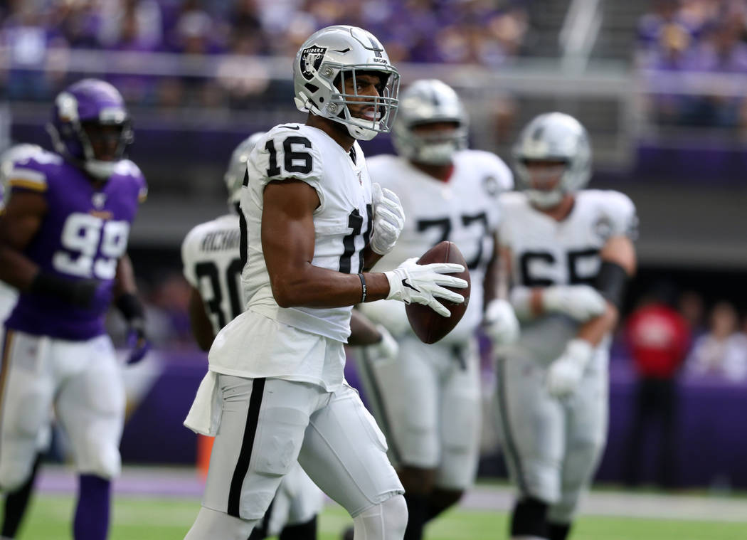 Oakland Raiders wide receiver Tyrell Williams (16) holds on the football after making a catch d ...