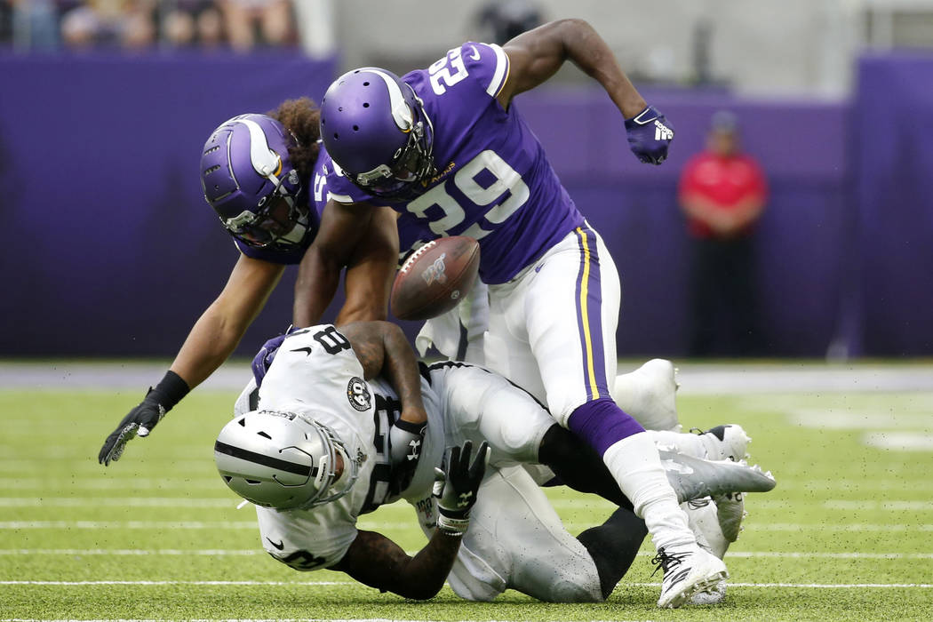 Oakland Raiders tight end Darren Waller fumbles after getting hit by Minnesota Vikings defender ...