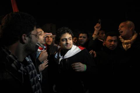 FILE - In this Feb. 10, 2011 file photo, Egyptian Wael Ghonim, center, walks into Tahrir Squar ...
