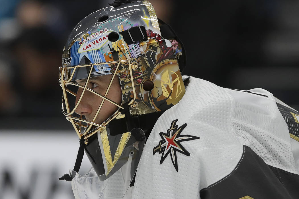 Vegas Golden Knights goaltender Marc-Andre Fleury watches action while defending his net during ...