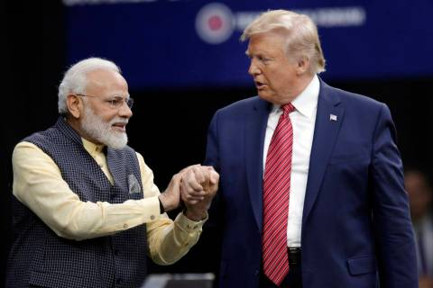 Prime Minister Narendra Modi and President Donald Trump shake hands after introductions during ...
