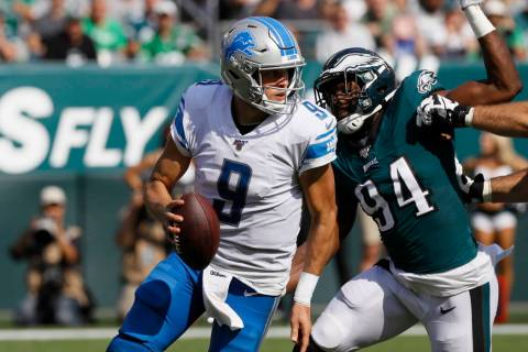 Detroit Lions' Matthew Stafford in action during the second half of an NFL football game agains ...