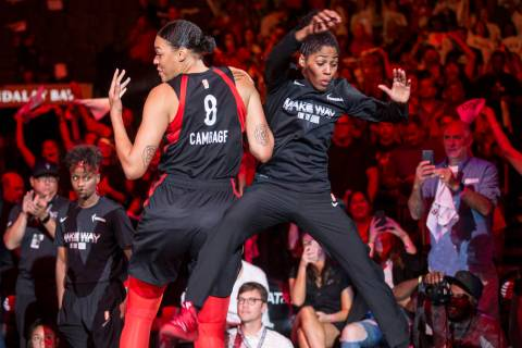 Las Vegas Aces center Liz Cambage (8) gets fired up with teammate Sydney Colson (51) before the ...