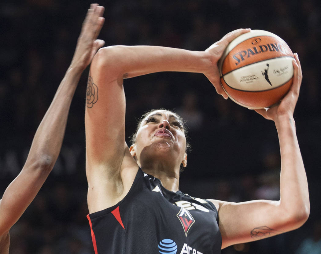 Las Vegas Aces center Liz Cambage (8) drives to the basket in the second quarter of Vegas' WNBA ...