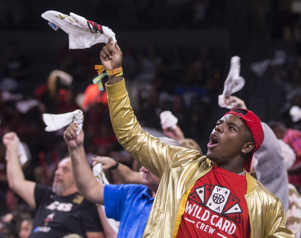 Las Vegas Aces Wild Card Crew member Jeremiah Williams fires up the crowd in the second quarter ...