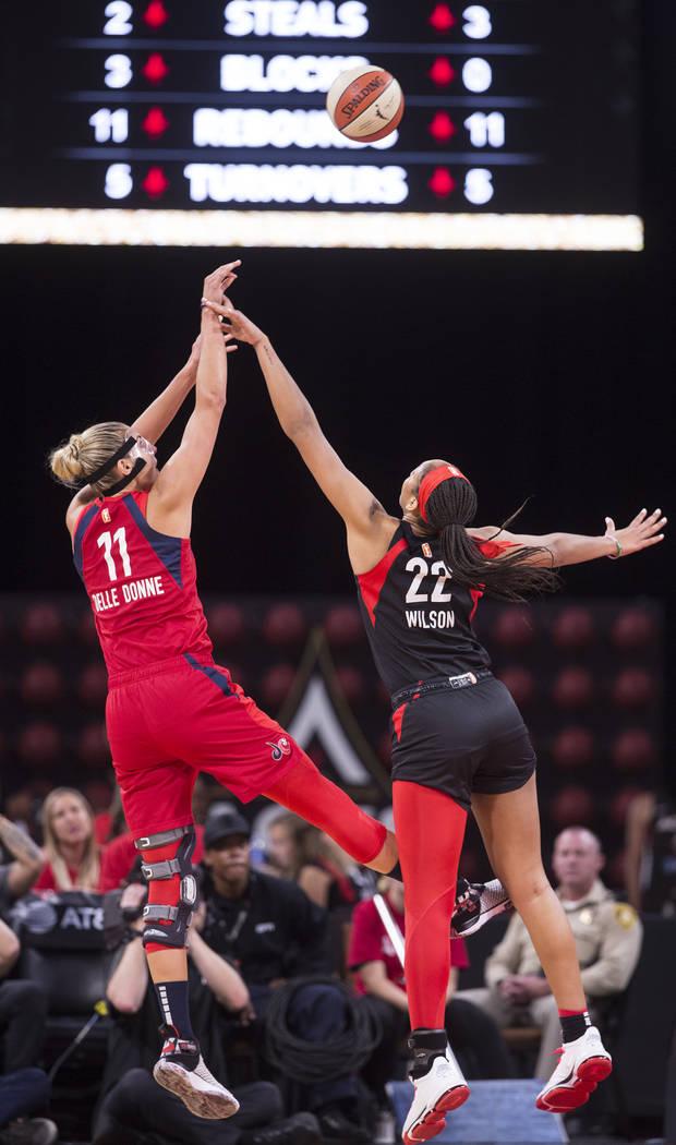 Las Vegas Aces center A'ja Wilson (22) defends Washington Mystics forward Elena Delle Donne (11 ...