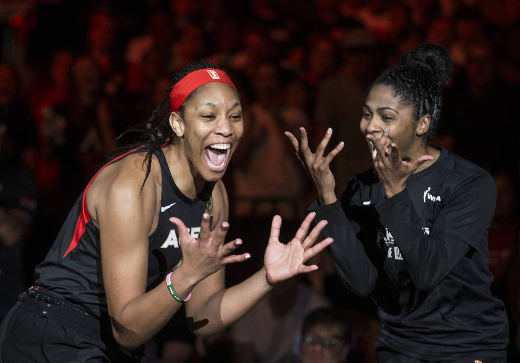 Las Vegas Aces center A'ja Wilson (22) gets fired up with teammate Sydney Colson (51) before th ...