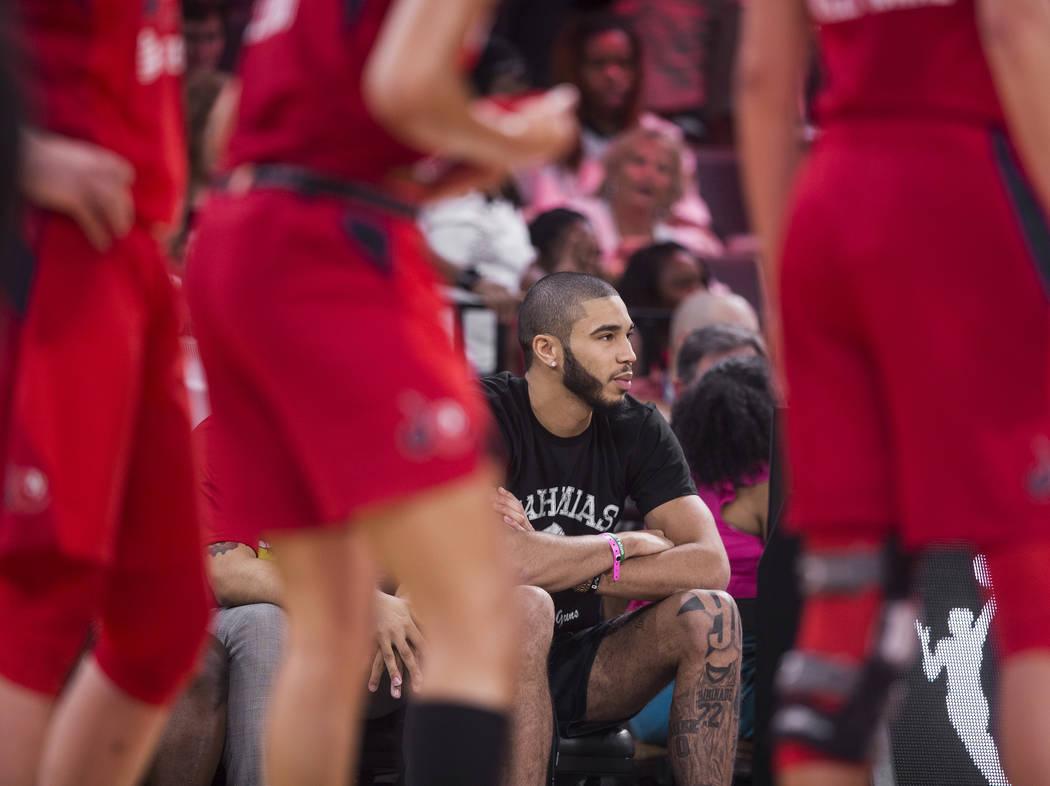 Boston Celtics forward Jayson Tatum watches the Las Vegas Aces WNBA semifinals game with the Wa ...