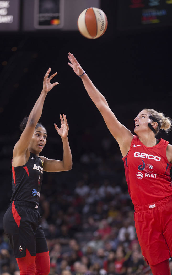 Las Vegas Aces guard Sydney Colson (51) shoots over Washington Mystics forward Elena Delle Donn ...