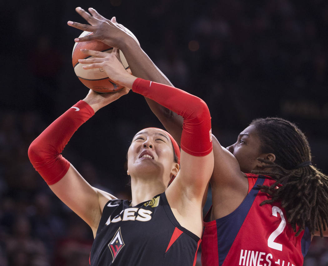 Las Vegas Aces center Ji-Su Park (19) gets fouled by Washington Mystics forward Myisha Hines-Al ...