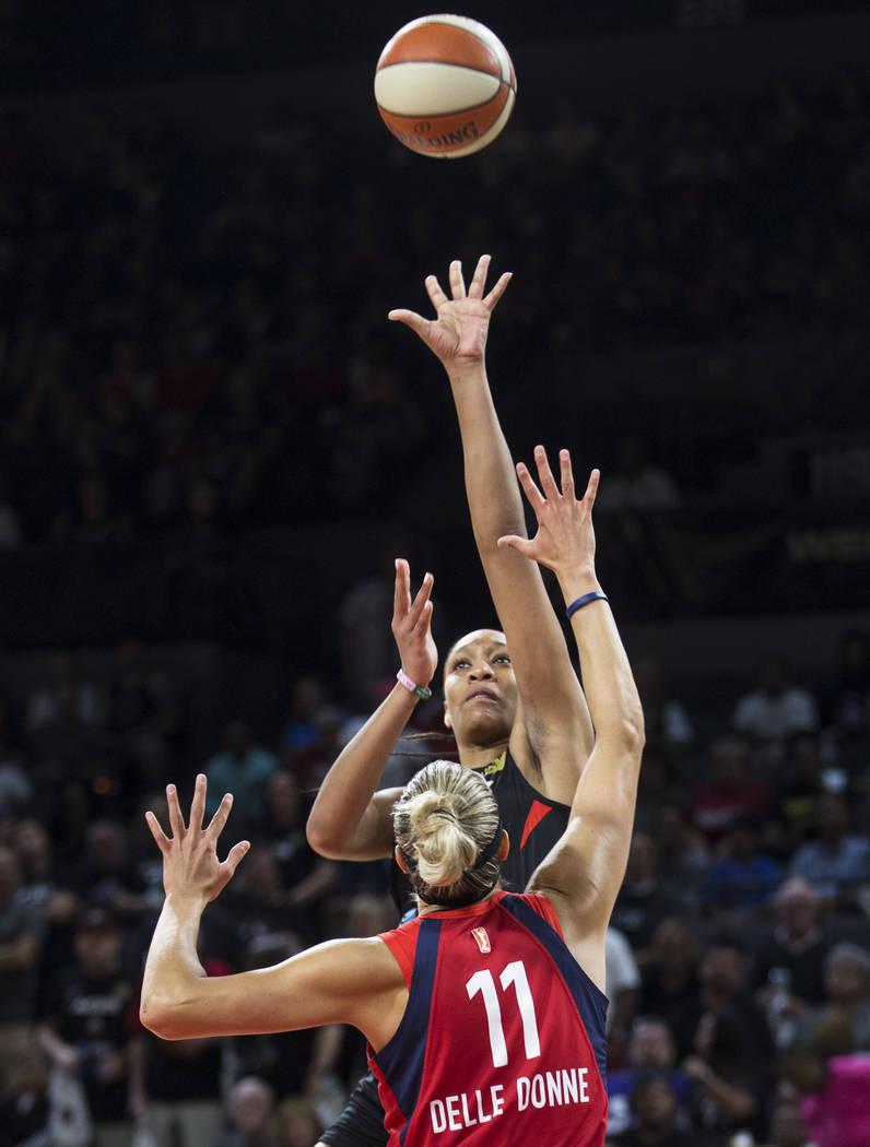 Las Vegas Aces center A'ja Wilson (22) shoots over Washington Mystics forward Elena Delle Donne ...