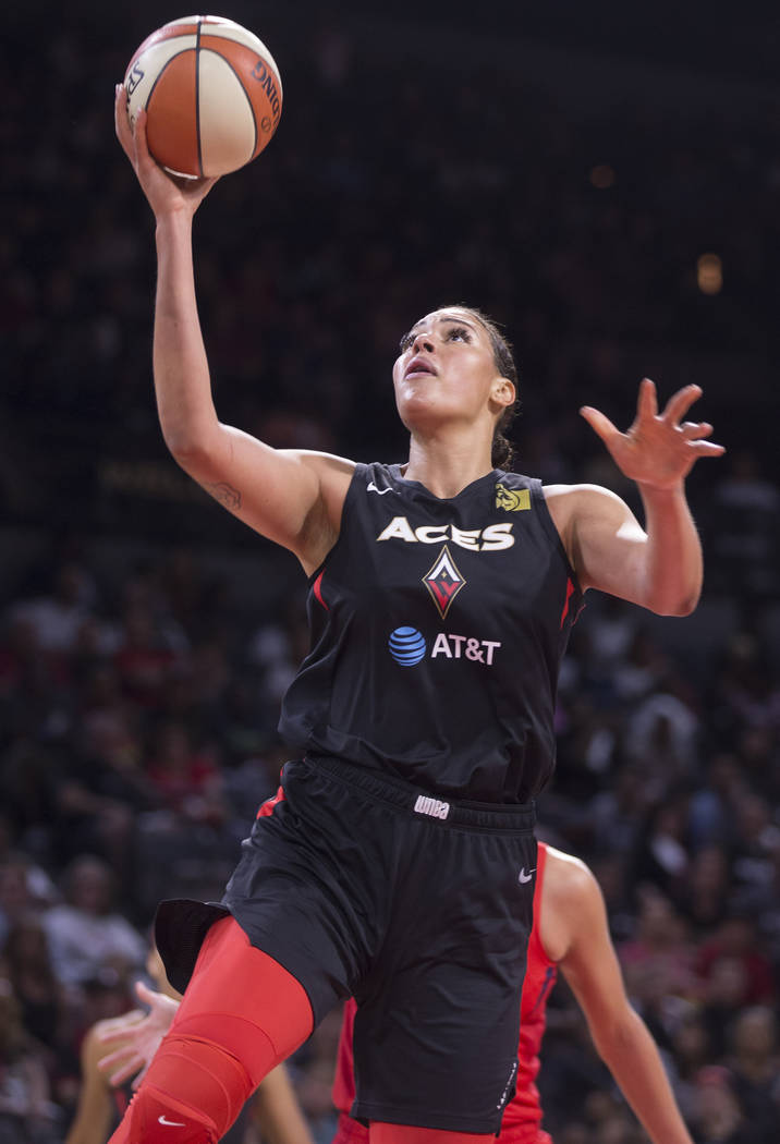 Las Vegas Aces center Liz Cambage (8) drives to the basket in the third quarter of Vegas' WNBA ...