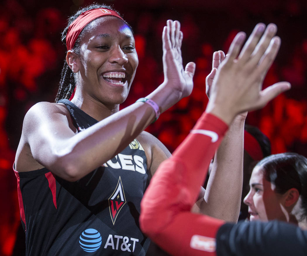 Las Vegas Aces center A'ja Wilson (22) gets fired up with teammates before the start of Vegas' ...