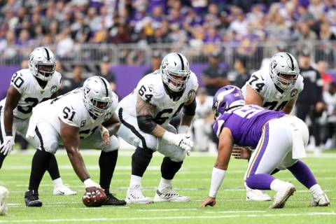 Oakland Raiders center Rodney Hudson (61) prepares to hike the football as guard Richie Incogni ...