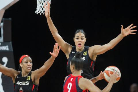 Las Vegas Aces center A'ja Wilson (22) and Las Vegas Aces center Liz Cambage (8) defend Washing ...