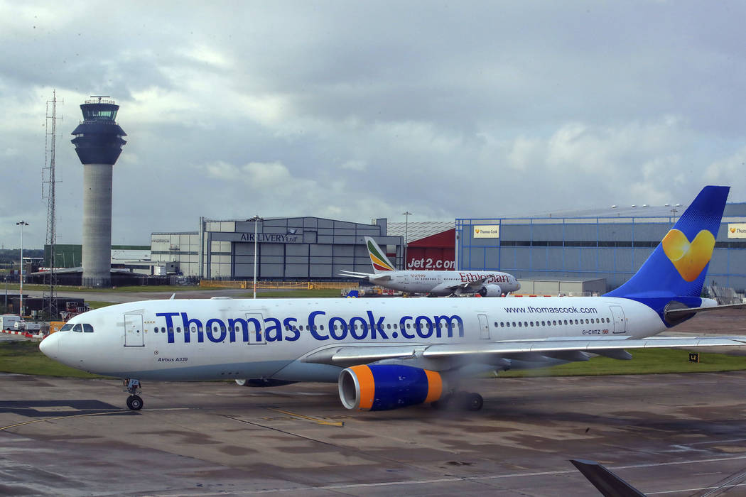 FILE - In this Aug. 13, 2019 file photo a Thomas Cook plane taxis on the runway at terminal one ...