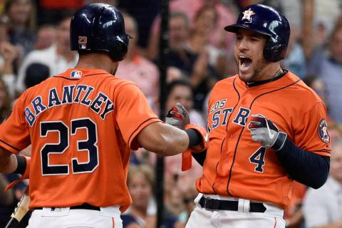 Houston Astros' George Springer, right, celebrates his two-run home run off Los Angeles Angels ...